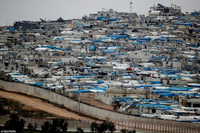 Tents housing internally displaced people in Atma camp in Idlib Governorate of Syria are seen on the Syrian side of the border zone near the Turkish village of Bukulmez