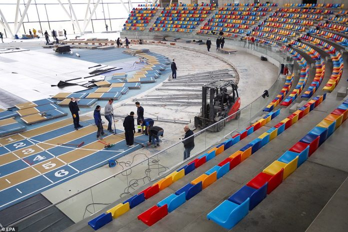 Workers dismantle the Catalunya Indoor Athletics Track as the arena is converted into a temporary hospital in Barcelona