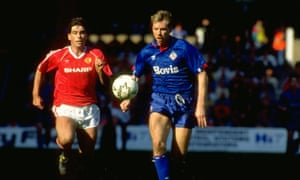 Neil Webb of Manchester United chases after Andy Holden of Oldham.