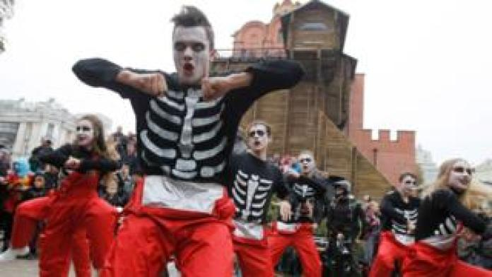 Dancers wearing make-up and zombie costumes attend the Halloween parade in Kiev in 2019