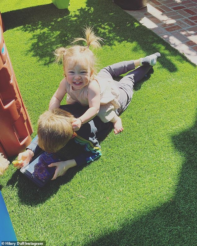 Kids at play:The day before she said that her two kids - Luca and Banks - were doing fine at home. She added that her son Luca has a 'sweet bond' with his younger sister Banks helped ease her mum 'guilt'