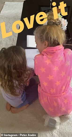 Nice moments: However, there were some heartwarming moments of his day as eldest daughter Princess helped little Amelia with her homework, telling her 'That's helping me a lot'