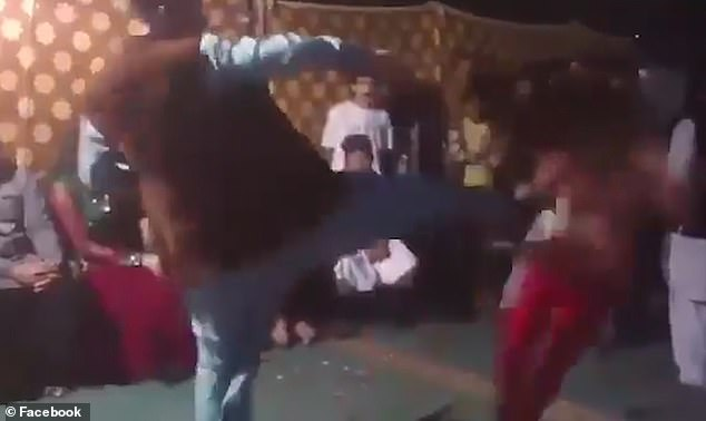 The victim falls backwards out of view. In the aftermath of the incident, another man at the event is seen approaching the perpetrator, who was holding a Fanta bottle when he carried out the attack