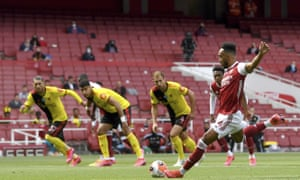 Pierre-Emerick Aubameyang scores from the penalty spot for Arsenal against Watford.