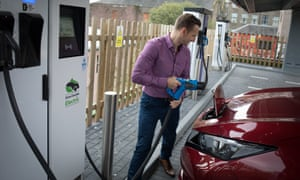 Ryan Todd charges his car at the Princes Street Electrical Charging Station in Dundee