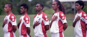 Jaiyah Saelua (second right) sings the national anthem before playing for the American Sāmoa football team Stills taken from 'Next Goal Wins'.