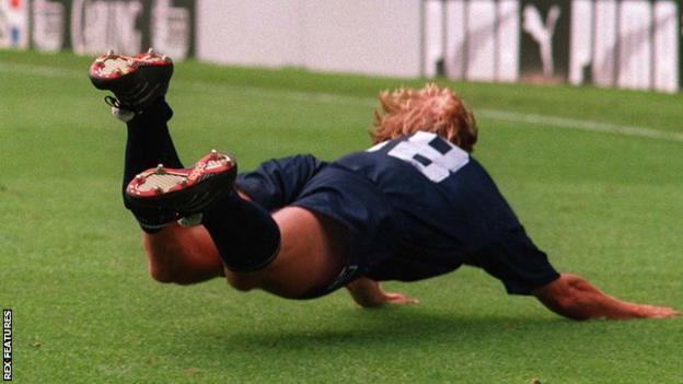 Jurgen Klinsmann celebrates scoring for Tottenham with a dive