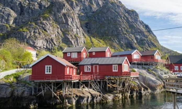 Red wooden rorbus fishermen's huts in Moskenesoya Island, Lofoten Islands, Norway