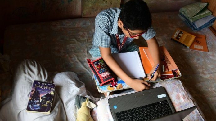 Student takes online classes in India