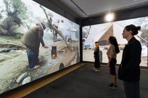 People inside the Life in a Camp exhibit