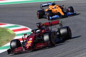 Sebastian Vettel in the deep burgundy Ferrari