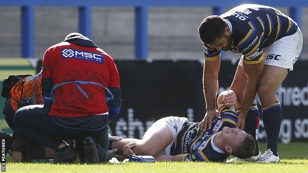 Leeds' Harry Newman receives treatment