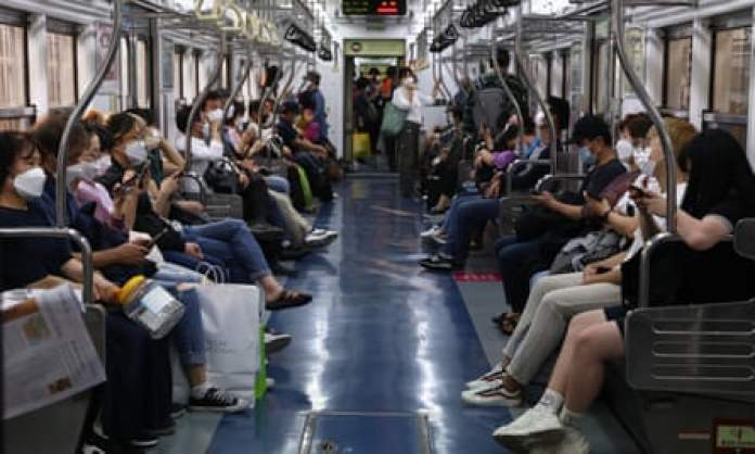 South Koreans wear masks on the subway to protect themselves against the spread of coronavirus.