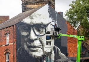 The artist Irek Jasutowicz works on a mural of Marcelo Bielsa near Hyde Park in Leeds this week.