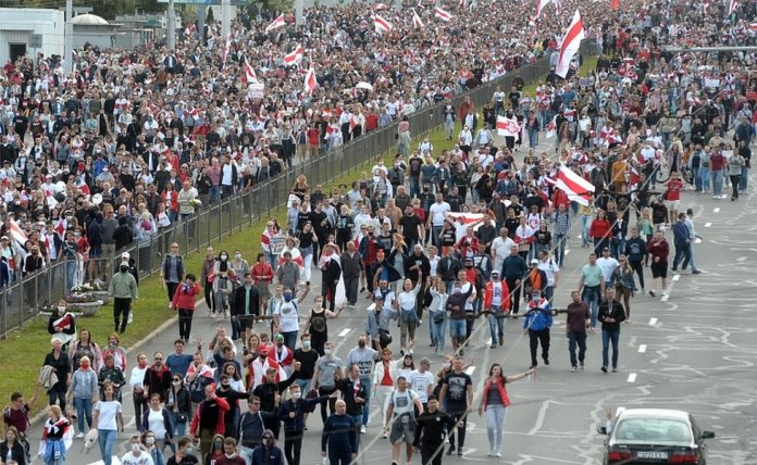 Protesters march during a rally to protest against the presidential election results in Minsk, Belarus, 13 September 2020