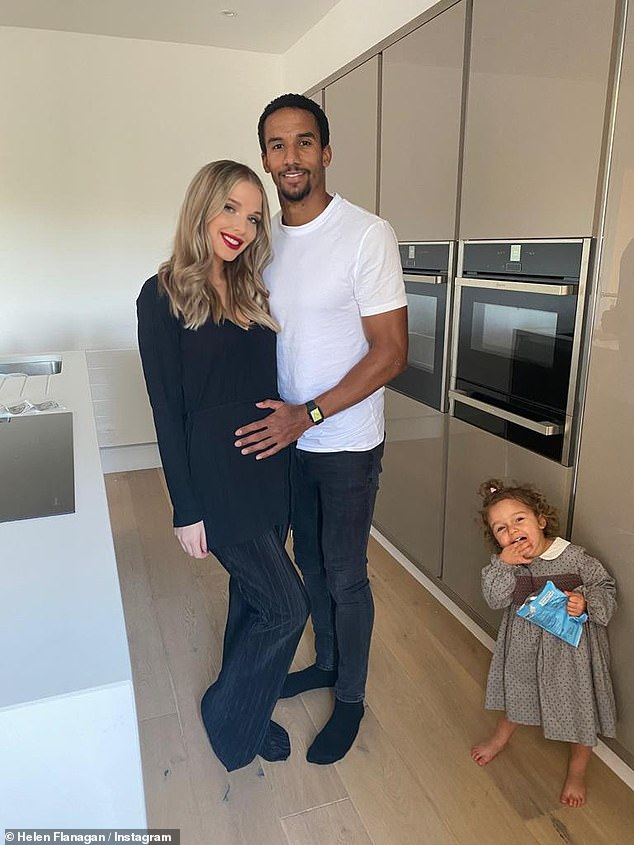 Family:The actress took to Instagram on Tuesday to reveal she is 'so relieved' to be over the worst of hyperemis gravidum (pictured withfiancé Scott Sinclair, 31, and Delilah, two)