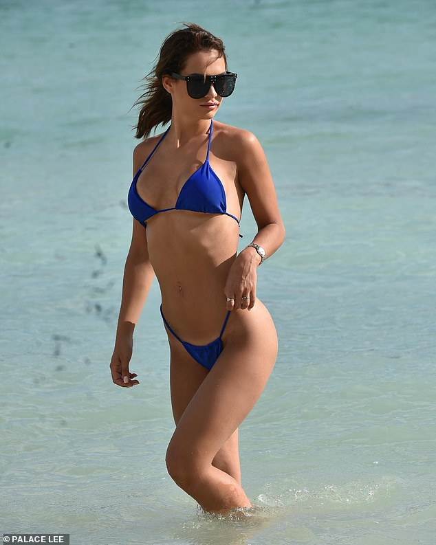 Sexy:The TOWIE star slipped into the revealing two-piece as she enjoyed a dip in the ocean during her sunny Greek break