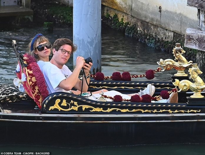 Snap decision: The British actor caught as much of the action as possible on his camera as they pair rode through the canals