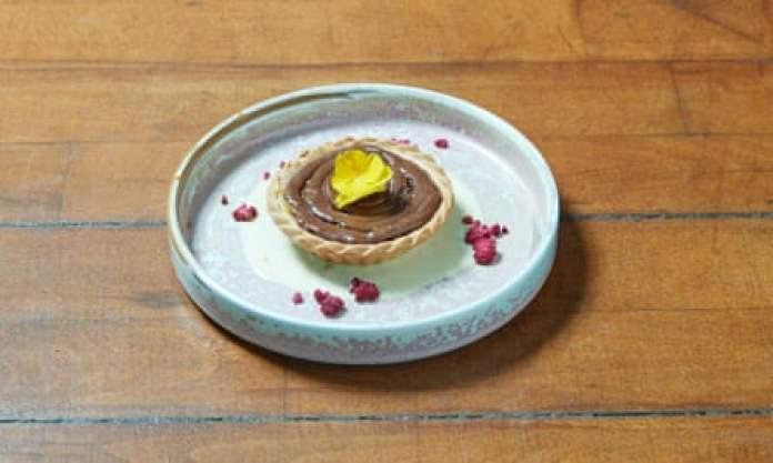 'Sits in a puddle of spiced custard': gaja halwa tart.
