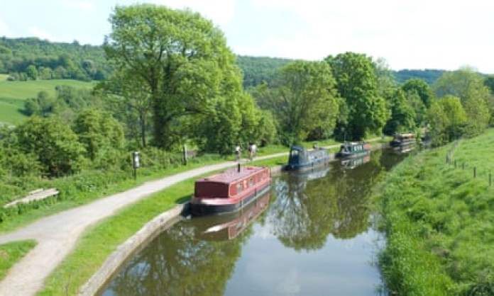 Boats lined up alongside the Avon and Kennet Canal in the village of Claverton