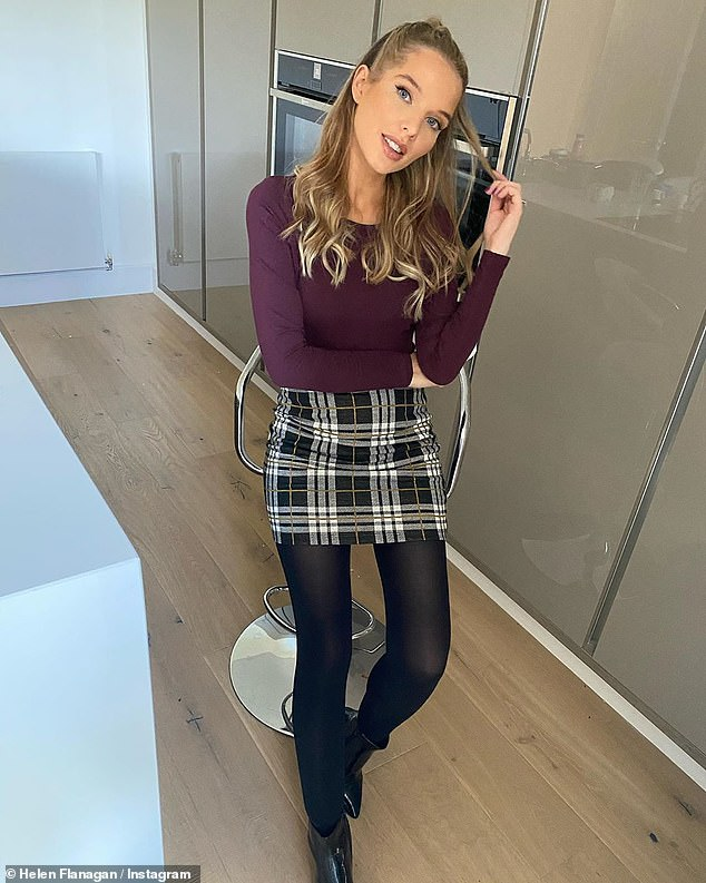 Looking good:Helen, who played Rosie Webster in the ITV soap, looked effortlessly stylish as she posed on a stool in her sleek kitchen