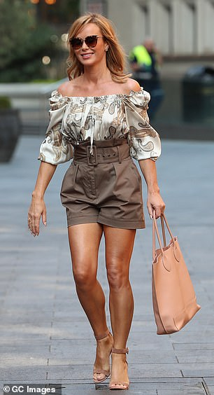 Svelte: The high-waisted shorts were cinched in at the waist showing off her youthful figure