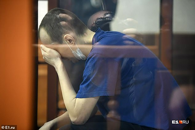 Alexandrov (pictured crying in court), is 'happily married' with a three-year-old son, worked at alinin Machine-Building Plant, which makes Russian anti-aircraft missile systems