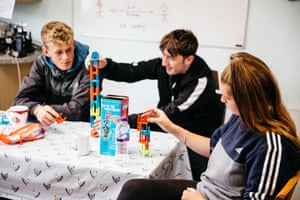 Jordan Ellis (left) Jaryn Taylor (centre) and Maryanne play games on a tea break.