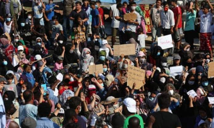 Asylum seekers protest against the new camp at Kara Tepe on Lesbos island, Greece on 12 September.