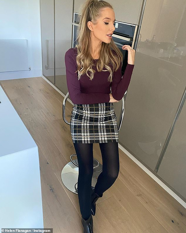 Style:The star covered her growing baby bump in a plum coloured jumper and a black and white checked mini skirt, finishing off her look with black tights and ankle boots