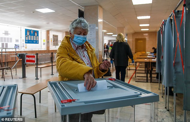 A woman casts a ballot during municipal elections in Tomsk, Russia on September 13