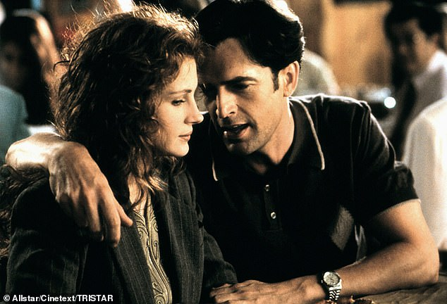Rupert Everett is pictured above with Julia Roberts in My Best Friend's Wedding (1997)