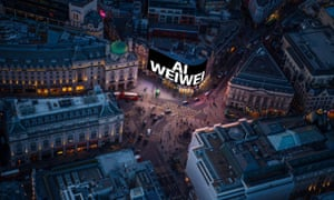 Ai Weiwei's work is projected on to a screen at Piccadilly Circus (aerial shot).