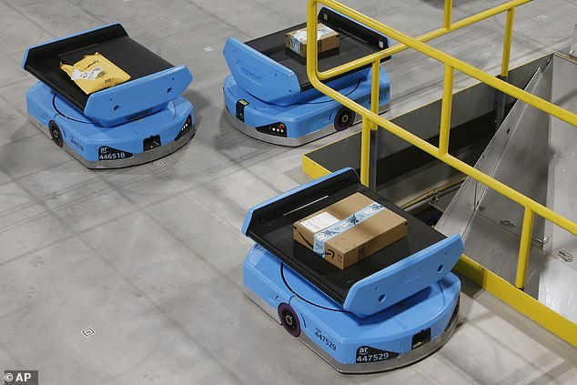 Amazon robots pictured above moving packages on December 17 at a warehouse in Goodyear, Arizona. Internal records from 150 warehouses show serious injuries were 50 percent higher at facilities with robots