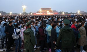 Watch the flag-raising ceremony at Tiananmen Square in Beijing.