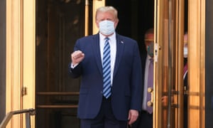 US President Donald Trump makes a fist as he walks out the front doors of Walter Reed National Military Medical Center after a fourth day of treatment for the coronavirus disease (COVID-19) as he heads to the Marine One helicopter to return to the White House in Washington from the hospital in Bethesda, Maryland, US, 5 October 2020.