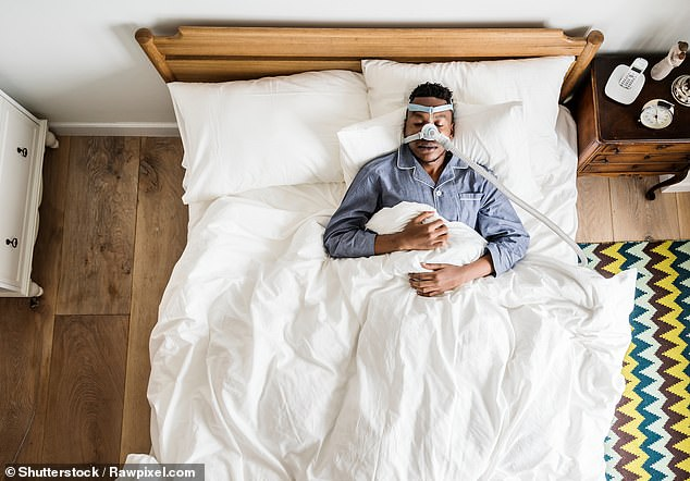 The new tablet eases the symptoms of obstructive sleep apnoea (OSA) ¿ which affects up to two million people in Britain. Pictured: A man wears a sleep apnoea mask (file photo)