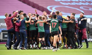 Aston Villa players and staff celebrate finding out they are staying in the Premier League after the 1-1 draw at West Ham on the last day of the season