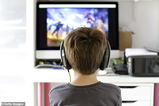 Zapping away for hours on video games has long been demonised for destroying teenagers' mental health, but it can actually make them happy, according to a survey. Pictured: Stock image