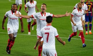Luuk De Jong (centre) celebrates with teammates after putting Sevilla ahead at Barcelona on Sunday.