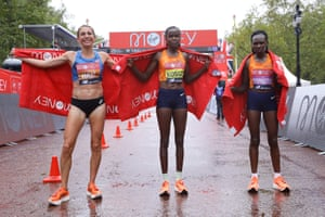Left to right: Sara Hall, winner Brigid Kosgei Ruth Chepngetich pose for a photograph on The Mall