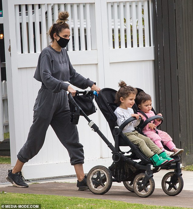 New home: The Bachelor's Sam Wood and Snezana Markoski have 'permanently relocated' to the Mornington Peninsula, despite Melbourne's stage-four lockdown. Pictured:Snezana and her daughters Charlie, one, and Willow, two, leaving the family's rented home on Wednesday