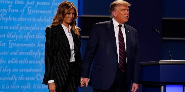 President Donald Trump and first lady Melania Trump on stage at the end of the first presidential debate Tuesday, Sept. 29, 2020, at Case Western University and Cleveland Clinic, in Cleveland, Ohio. (AP Photo/Patrick Semansky)