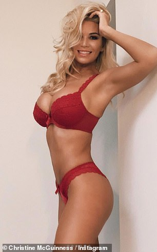 Sizzling: The glamour model, 32, worked her angles for the camera and flaunted her ample assets in a busty red lace bra, teamed with matching knickers
