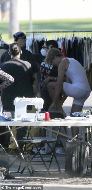 Wardrobe:He was also seen changing outfits, wearing just a white tank top and white boxer briefs as he changed along with several crew members