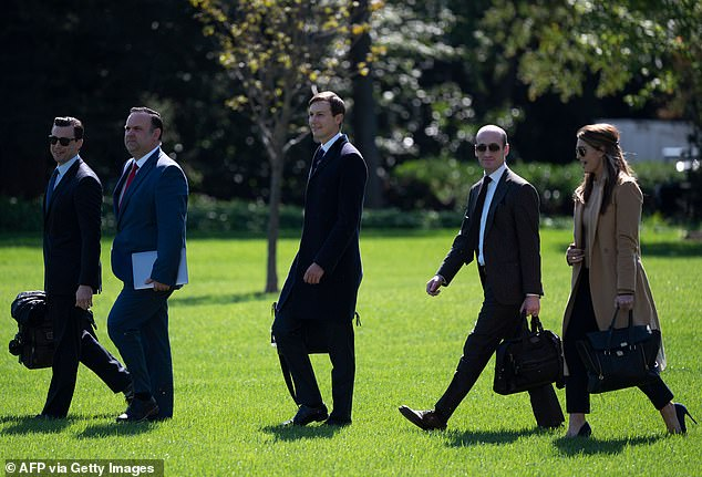 Hope Hicks hours before her diagnosis: Hope Hicks, far right, is pictured boarding Marine One on Wednesday. The President was also onboard alongside Stephen Miller, second from right, Jared Kushner, center. Her coronavirus diagnosis was announced the next day. They were on their way to Minnesota when this photograph was taken