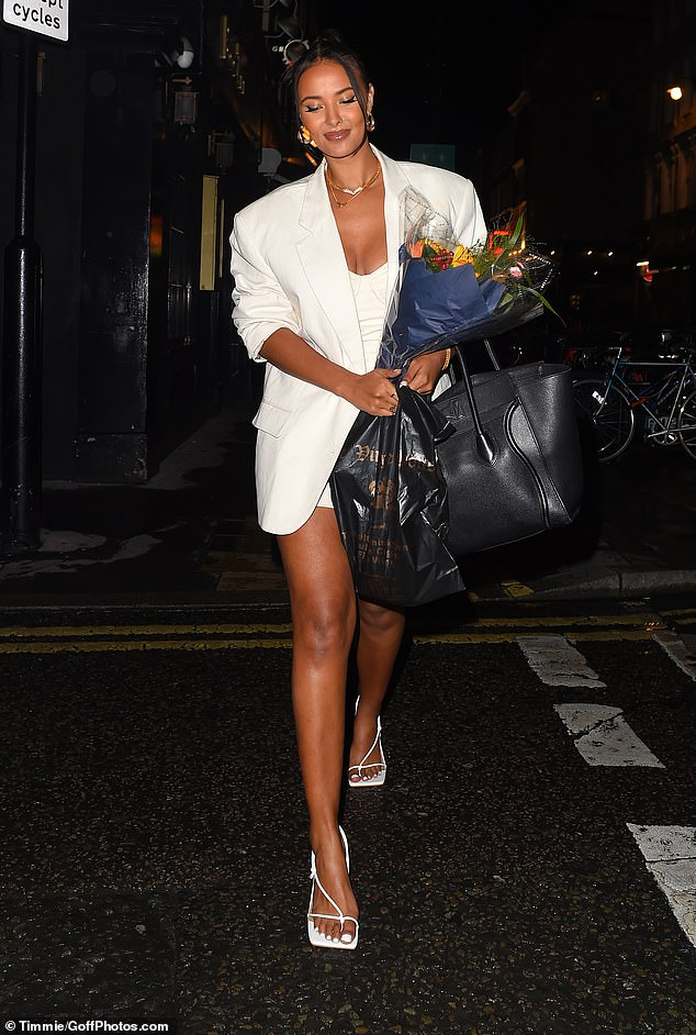 Arm candy: Maya was laden down with bags as she left the iconic venue