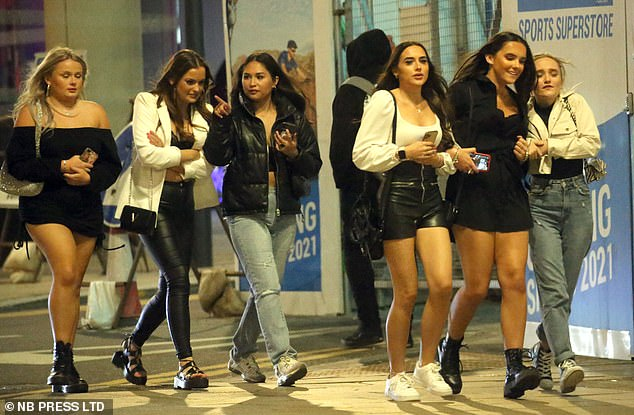 MPs overwhelmingly backed the controversial Rule of Six in a Commons vote tonight - but Boris Johnson was left in no doubt about the anger on the Tory backbenches. Pictured: Students ignoring the Rule of Six as they enjoy a night out in Leeds in September