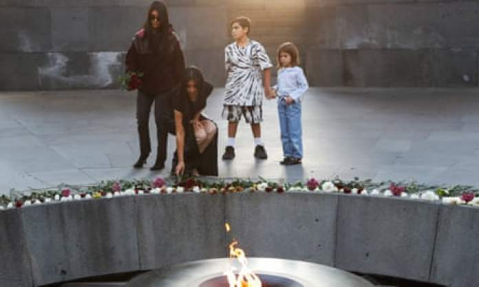 Kim and Kourtney Kardashian at the Armenian Genocide Memorial in Yerevan.
