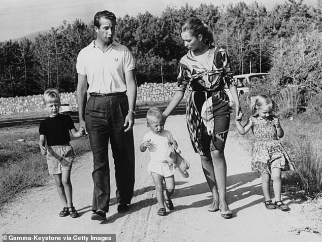Boel's lawyers said she was pleased that she would now be treated the same as Albert's three other children - Philippe (left), now King of Belgium, Prince Laurent (centre) and Princess Astrid (right) with their parents Albert and his wife Paola in 1965